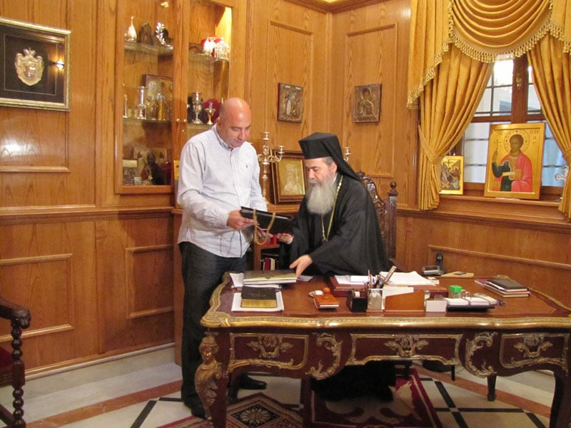 His Beatitude presenting a gift to the Minister