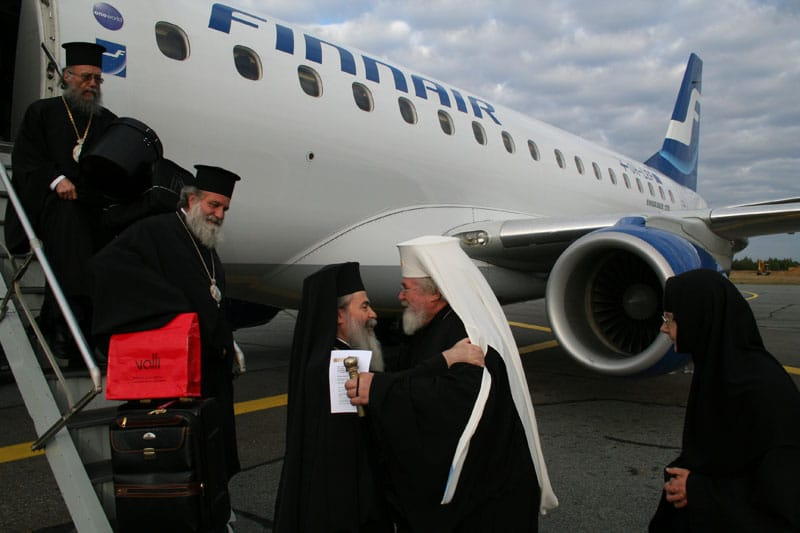 The reception for H.B from the Archbishop Leon at the airport.