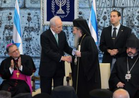 H. B. greeting His Excellency Mr. Peres the President of Israel.