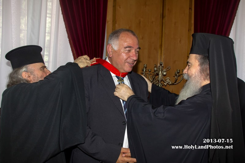 His Beatitude decorates Mr Mansour