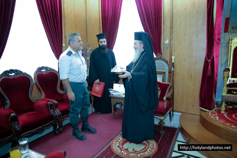 His Beatitude offering a commemorative gift to Mr Mansour