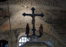 An old cross on top of the templon
