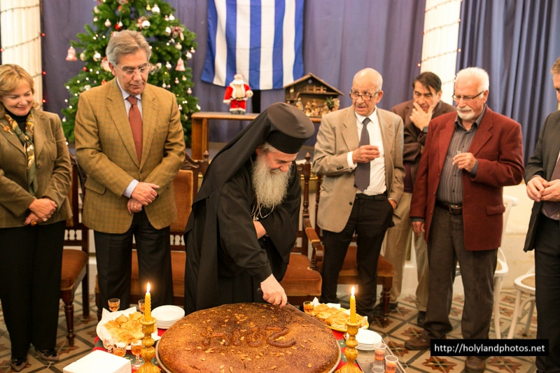 His Beatitude cuts St Basil's pie at the Greek Club
