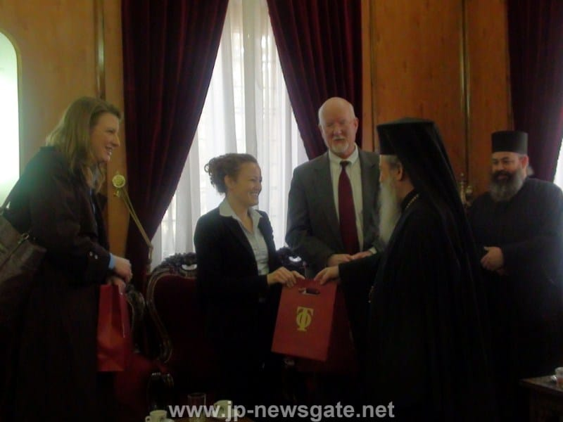 His Beatitude offering presents to the delegation