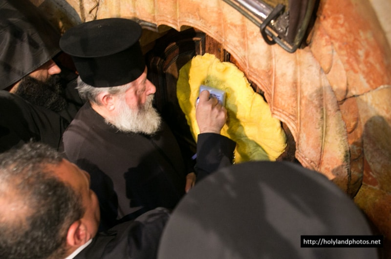 The Elder Dragoman holding the wax for the Holy Seal