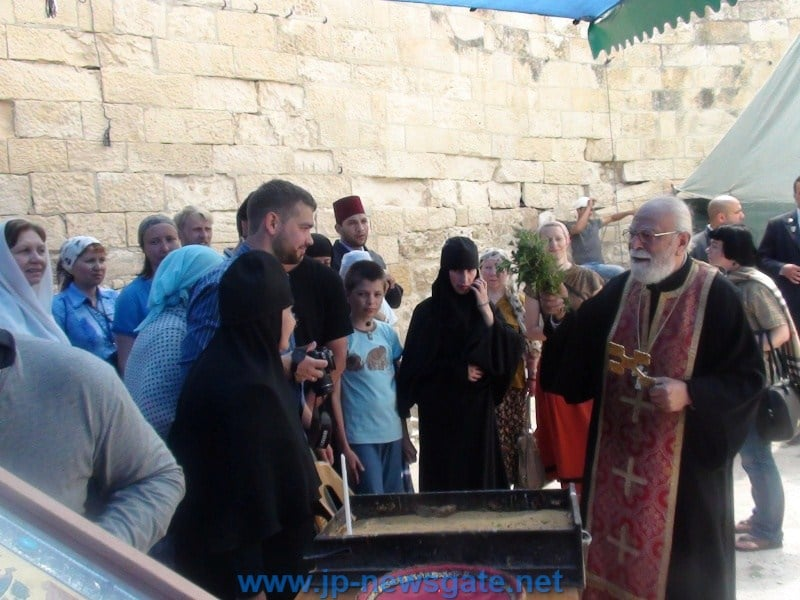 Father Issa blessing the waters on the open-air altar
