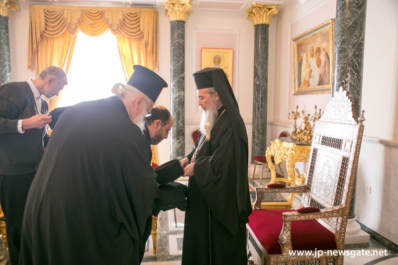 His Beatitude blesses the monastic habits of fathers Sergei and John