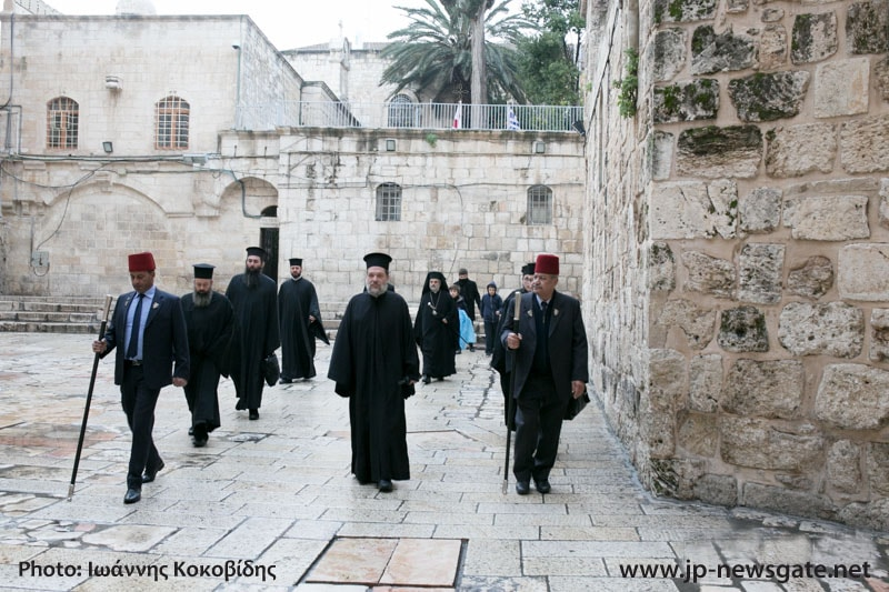 Fathers walking to the Church of the Resurrection