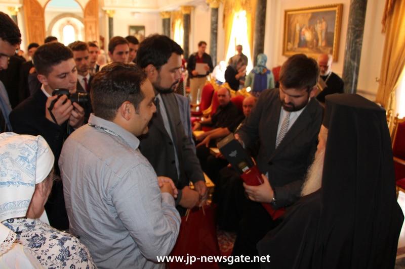 Students offer H.B. monastic wine