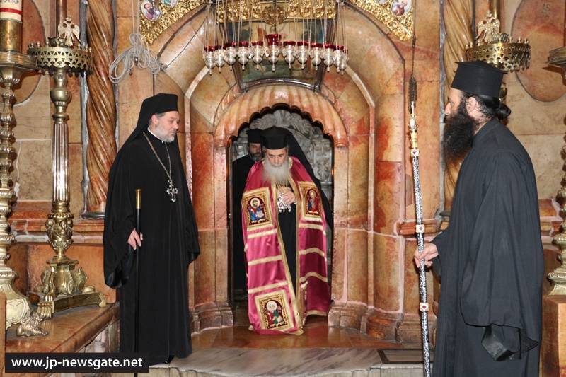 The Patriarch venerates at the Holy Sepulchre
