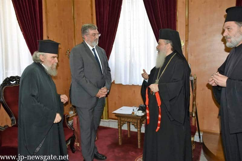 H.B. confers a medal on the Greek Ambassador