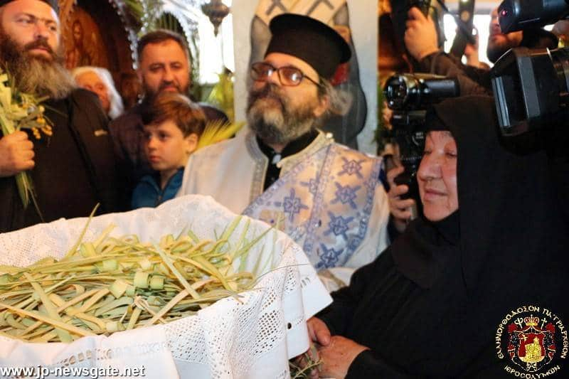 The Abbess of Bethsfagi Nun Savvina offering palm branches