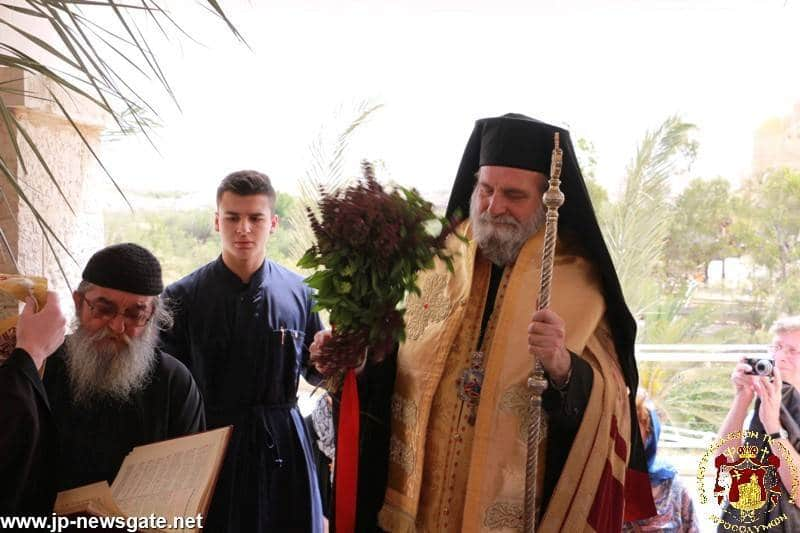 The Most Rev. Metropolitan Isychios of Kapitolias at the bank of the river Jordan